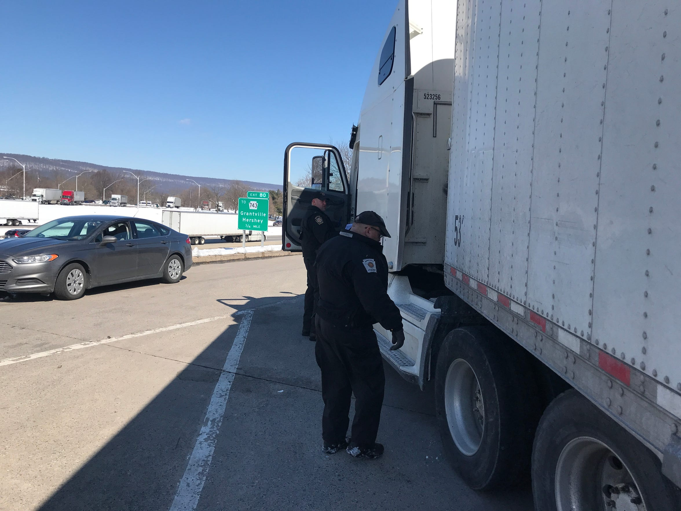 Pennsylvania state troopers run a checkpoint for tractor trailers at the Interstate 81 northbound mile 79.5 checkpoint near Grantville on March 5, 2019. Troopers confirm that drivers have active CDLs during the stop.