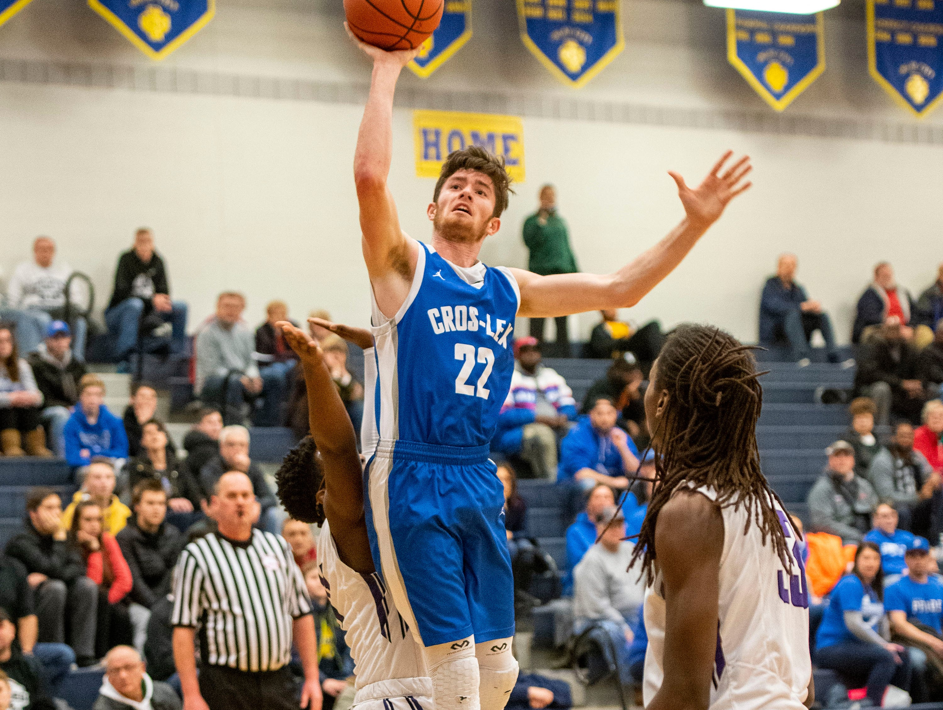 Cros-Lex High School's Tate Shaffer (22) jumps to score in the MHSAA Division 2 regional basketball game against Pontiac High School Tuesday, March 5, 2019 at Imlay City High School.
