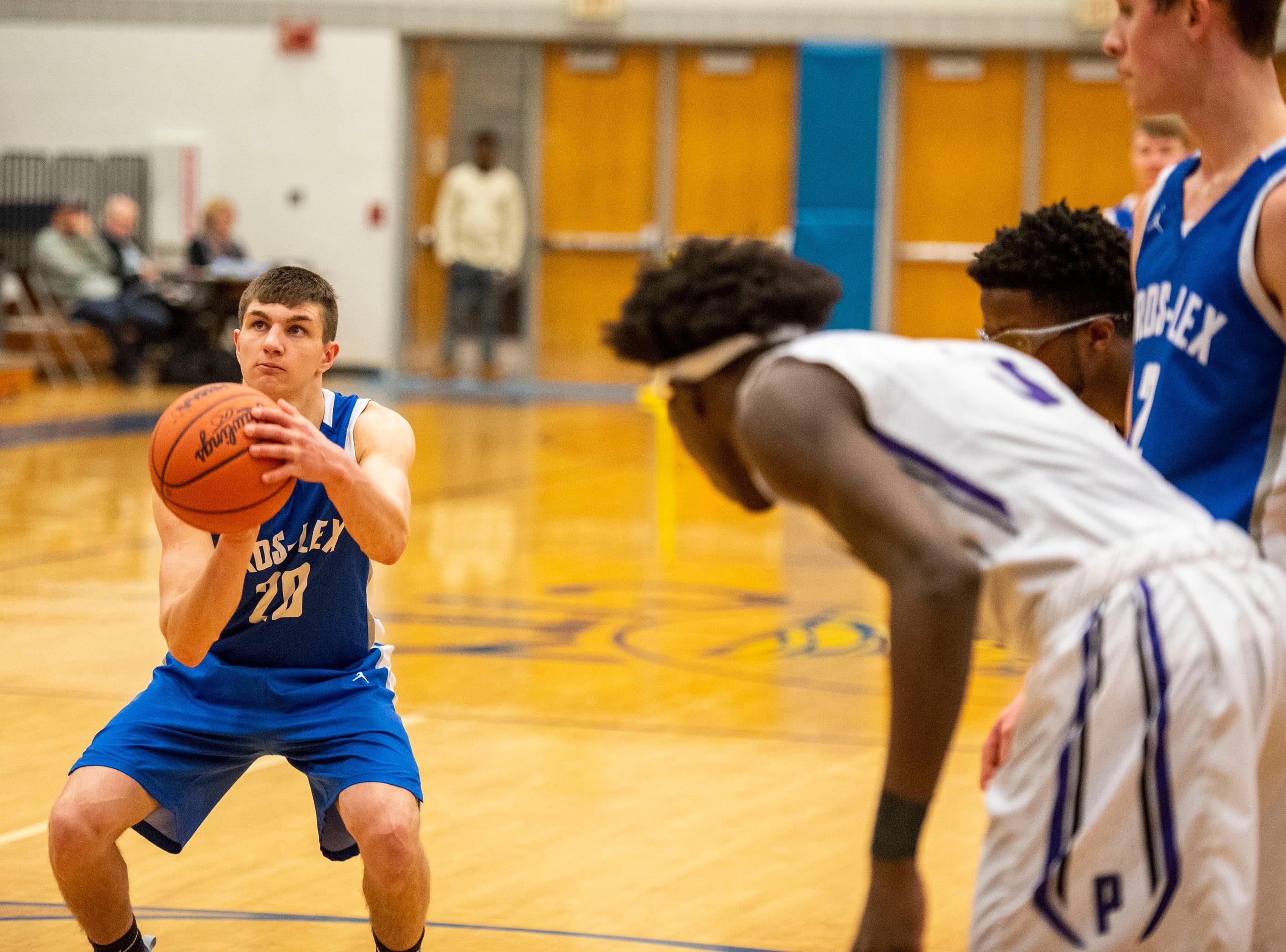 Cros-Lex High School's Jake Noll shoots a free throw in the MHSAA Division 2 regional basketball game against Pontiac High School Tuesday, March 5, 2019 at Imlay City High School.