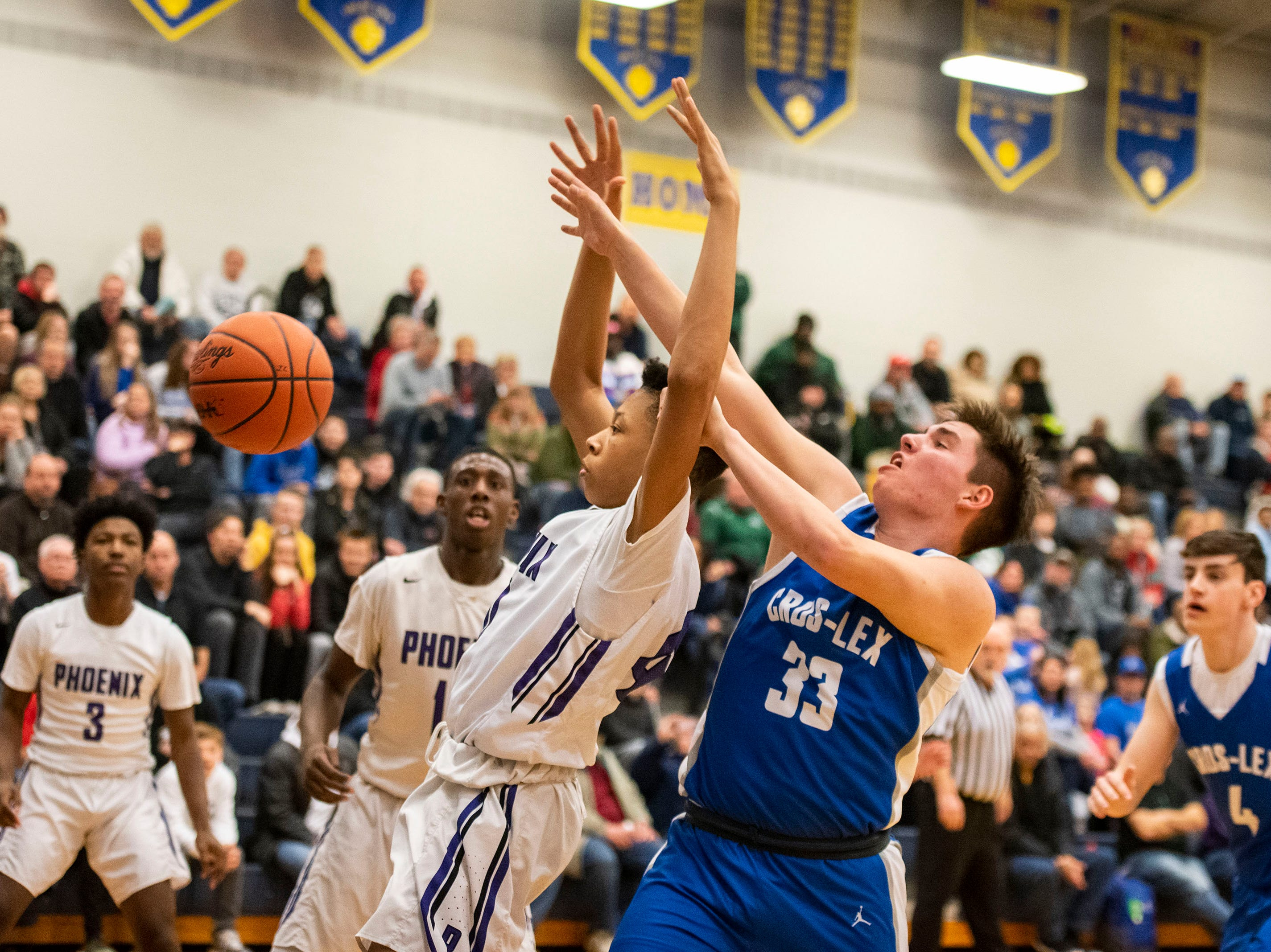 Cros-Lex's Nolan Durand (33)'s shot is blocked by a player from Pontiac High School in the MHSAA Division 2 regional basketball game Tuesday, March 5, 2019 at Imlay City High School.