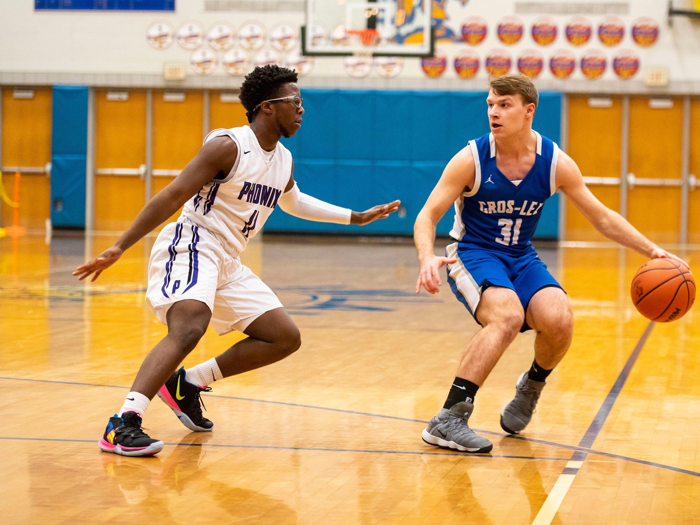 Pontiac's Keyshaun Shelmonson-Bey (11) defends against Cros-Lex High School's Matthew Kerrigan in the MHSAA Division 2 regional basketball game Tuesday, March 5, 2019 at Imlay City High School.
