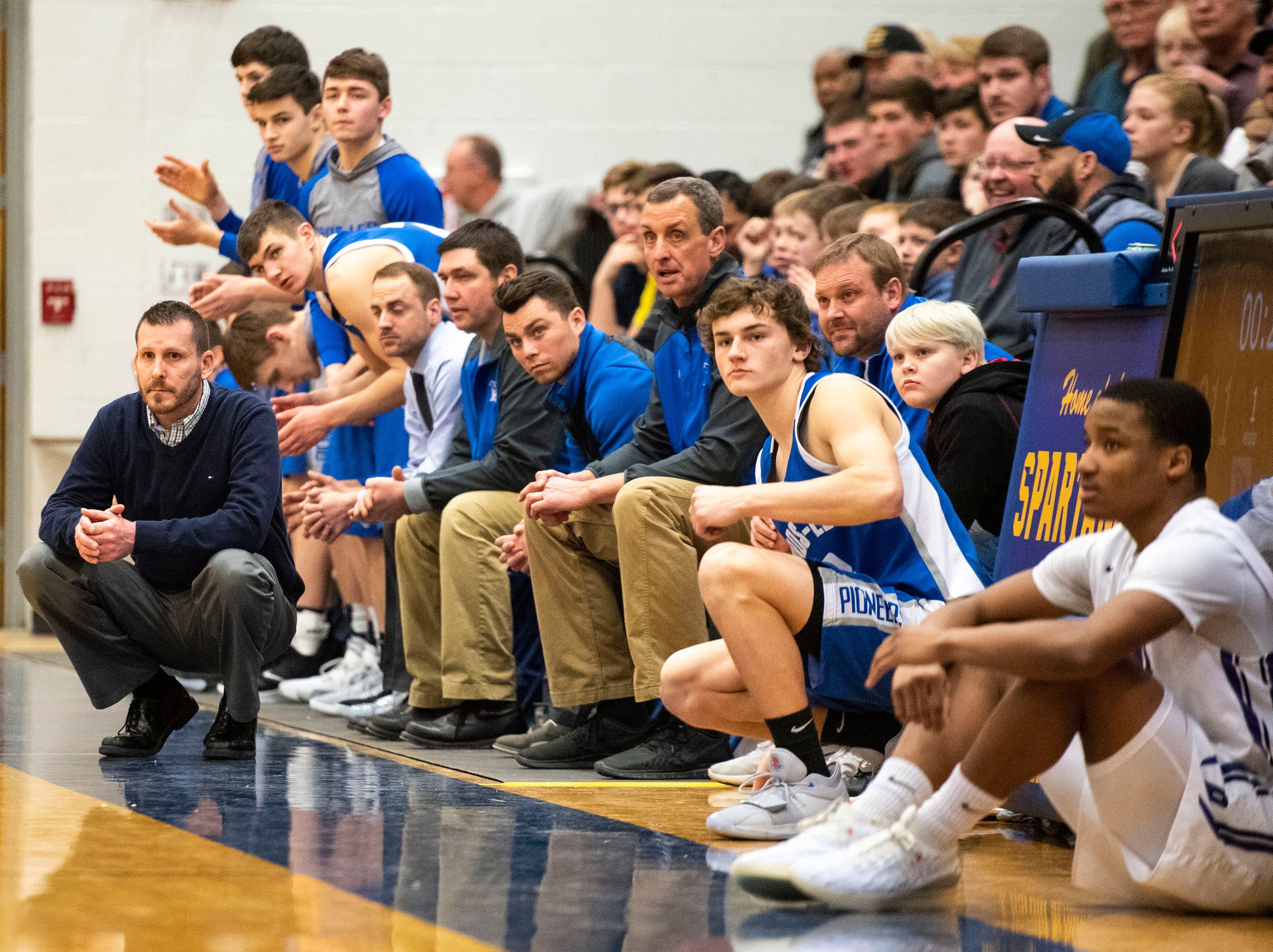 Cros-Lex High School head basketball coach Lance Campbell watches from the sidelines in the MHSAA Division 2 regional basketball game against Pontiac High School Tuesday, March 5, 2019 at Imlay City High School.