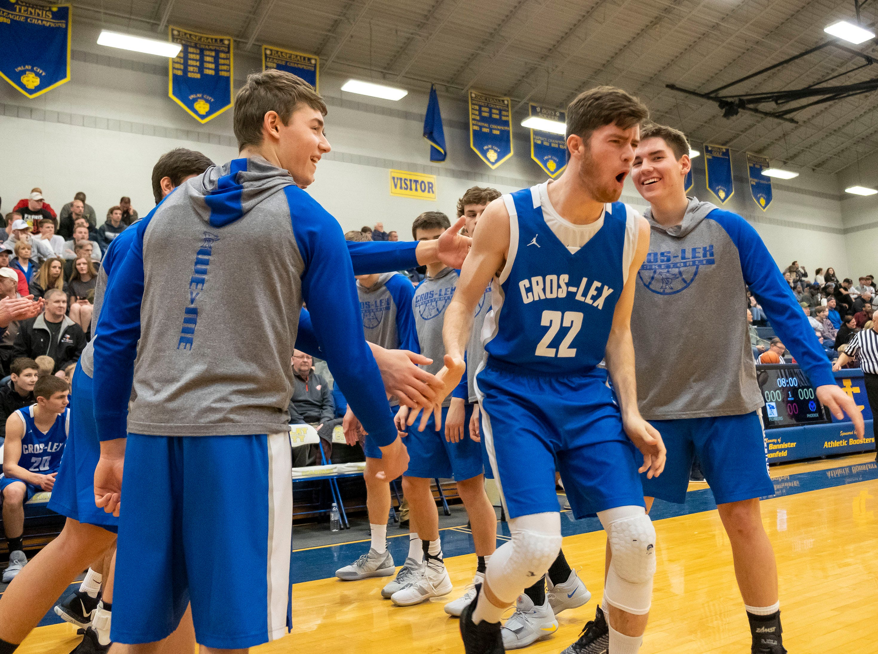 Cros-Lex High School's Tate Shaffer shouts as he takes the court before the MHSAA Division 2 regional basketball game against Pontiac High School Tuesday, March 5, 2019 at Imlay City High School.