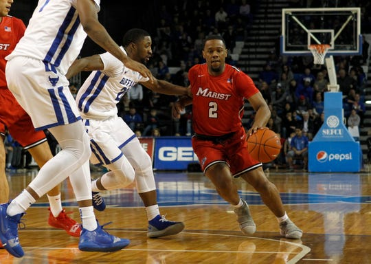 Buffalo Bulls guard Dontay Caruthers defends Marist Red Foxes guard Brian Parkeras he dribbles the ball during the second half at Alumni Arena in Buffalo on Nov. 24.