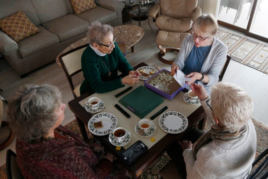 Members of the Poughkeepsie branch of the American Association of University Women, from left, Sue Doyle, Barbara Mindel, Pat Luczai and Bonnie Auchincloss play a round of Upwards on March 4, 2019. The group has been meeting for over twenty years to play board games once per month.