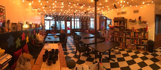 A panoramic view of the House Rules Café in Hudson, a restaurant that combines food and drink with playing board games.