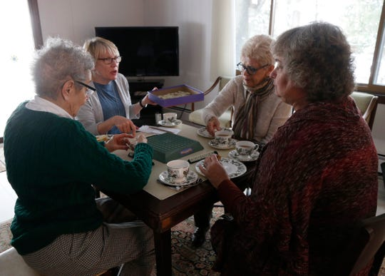 Members of the Poughkeepsie branch of the American Association of University Women, from left, Barbara Mindel, Pat Luczai, Bonnie Auchincloss and Sue Doyle  playing a round of Upwards on March 4, 2019. The group has been meeting for over twenty years to play board games once per month.