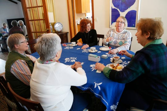 From left, Susan Fink, Linnea Masson, Carol Gray, Sharon Fleury and Ellie Charwat begin playing the card game Taboo during the monthly game meeting of the Poughkeepsie Branch of the American Association of University Women on March 4, 2019.