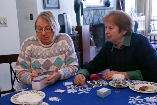 Members of the Poughkeepsie branch of the American Association of University Women, from left, Ellie Charwat and Sharon Fleury play the card game, Taboo on March 4, 2019. The group has been meeting for over twenty years to play board games once per month.