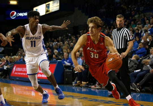 Buffalo Bulls forward Jeenathan Williams watches as Marist Red Foxes forward Ryan Funk dribbles to the basket during the second half at Alumni Arena in Buffalo on Nov. 24.