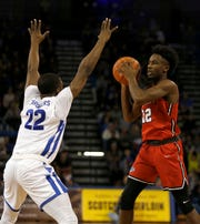 Marist Red Foxes guard Austin Williams looks to make a pass while Buffalo Bulls guard Dontay Caruthers defends during the second half at Alumni Arena in Buffalo on Nov. 24.