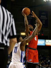 Marist Red Foxes forward Isaiah Lamb takes a shot during the second half as Buffalo Bulls forward Jeenathan Williams tries to defend during the second half at Alumni Arena in Buffalo on Nov. 24.