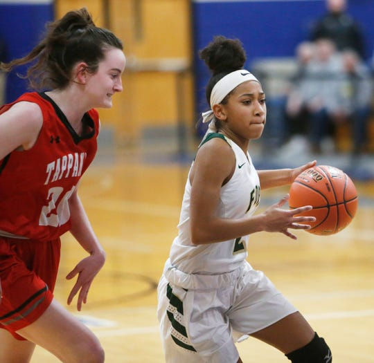 FDR's Deliah Smith drives to the net passed Tappan Zee's Kaleigh Beirne during the Class A girls basketball regional semifinal at Mount Saint Mary College on March 6, 2019.