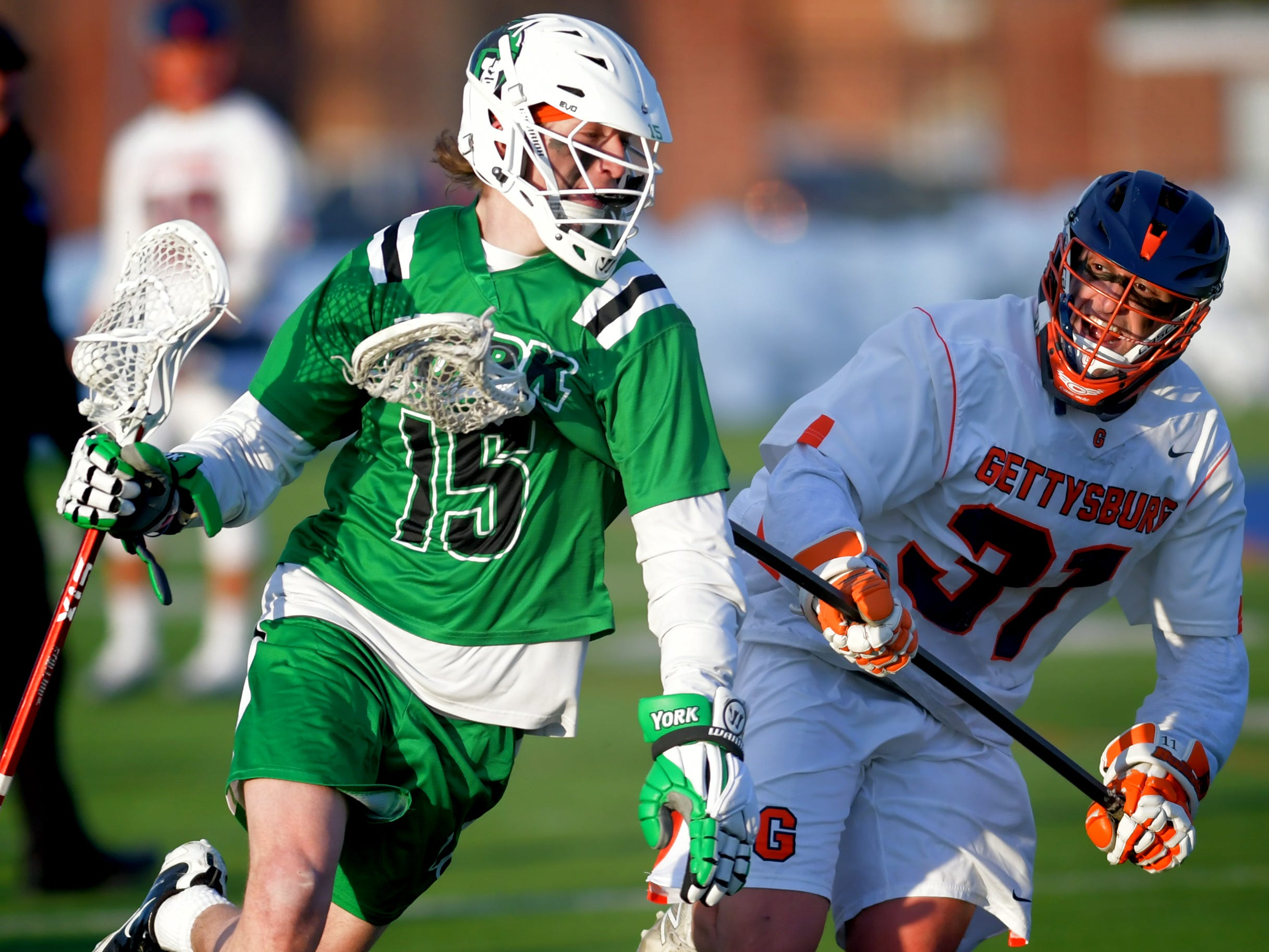 York College's Dylan Wolf moves the ball with Gettysburg College's Christian Atalese defending during lacrosse action at Gettysburg Wednesday, March 6, 2019. Both teams were ranked in the top 10 nationally in NCAA Division III men's lacrosse coming into the game. York won 14-6. Bill Kalina photo