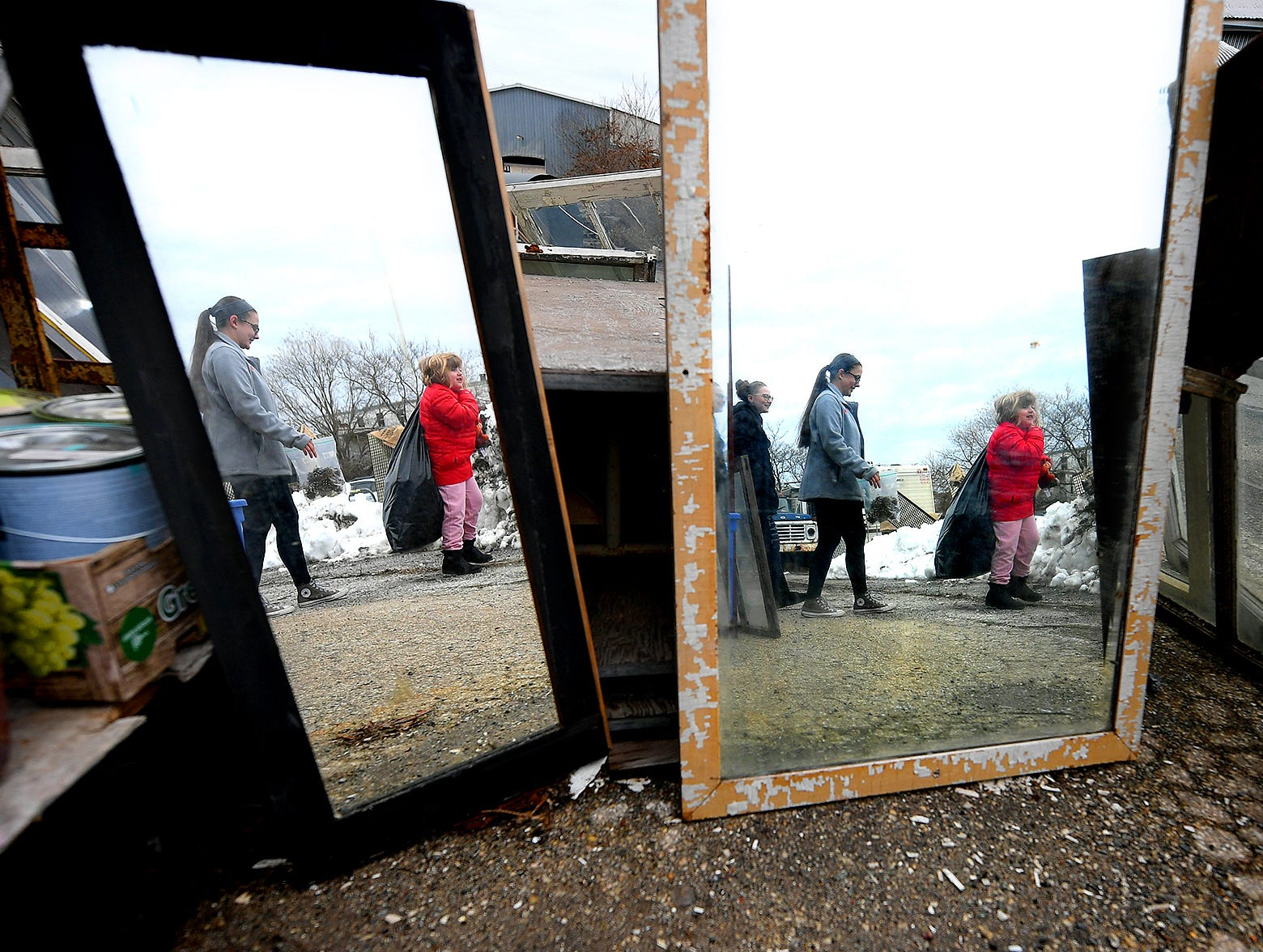 "Central High School sophomores Lea Wilhelm, left, Emma Crumling and Lea's sister Brynlee Dietrich, right, are reflected in vintage mirrors while choosing items for the sophomore's entry in the York County Solid Waste Authority Recycled Art Contest during ""Picker Day"" at the architectural salvage warehouse Refindings in York City Saturday, Feb. 23, 2019. The waste authority is sponsoring the fifth annual contest for York County high school students to promote recycling and celebrate Earth Day. Students create sculptures by mid-April from the materials donated by Refindings and the contest exhibit will be on display in the Marketview Arts Gallery, 37 W. Philadelphia St., beginning Sunday, April 14. Contest winners will be announced there during an awards event April 18. Bill Kalina photos"