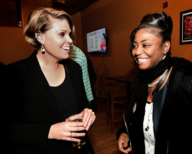 York County Clerk of Courts candidate Stacey Duckworth, left, York County Court of Common Pleas candidate Sandra Thompson talks during a petition-signing drive at Holy Hound Taproom in York City Tuesday, March 5, 2019. It is Democrat Duckworth's first run for public office. Bill Kalina photo