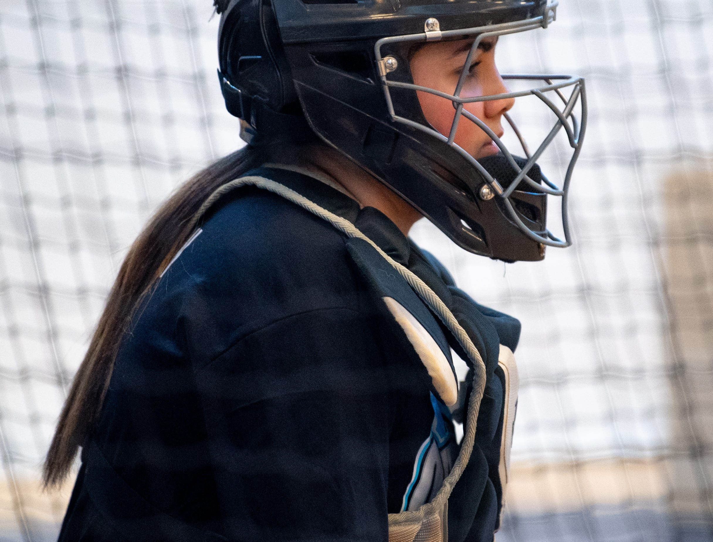 The catcher suggests what type of ball to throw during West York's softball practice, March 5, 2019.