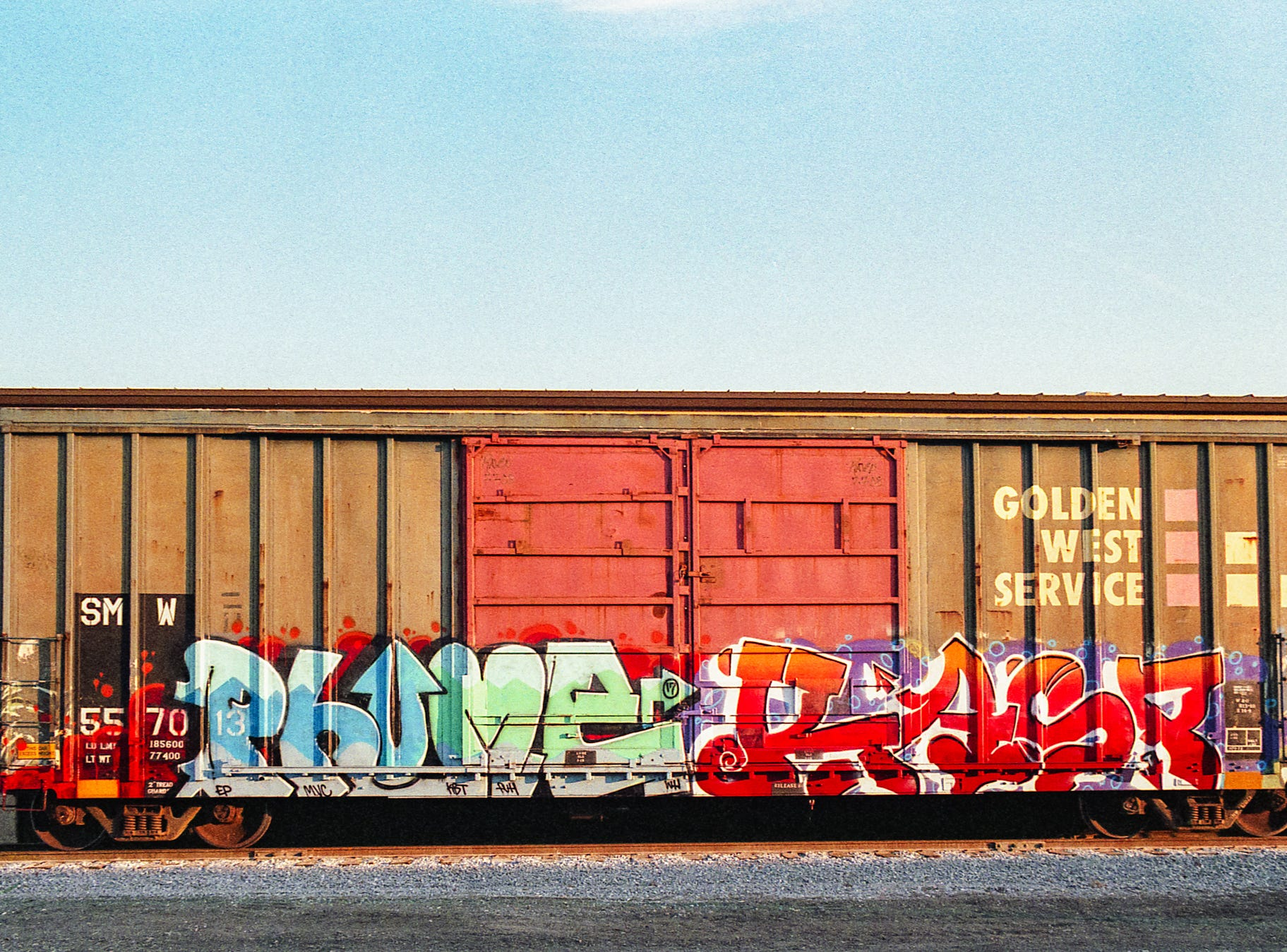 Every photo in this gallery was shot on vintage camera film by Nate Gentzler, a local photographer and member of the York Camera Club. He took these pictures around York.  This is a photo of a vibrant boxcar at the old train station on North Street. [Pentax MX] [Fuji Superia 400]