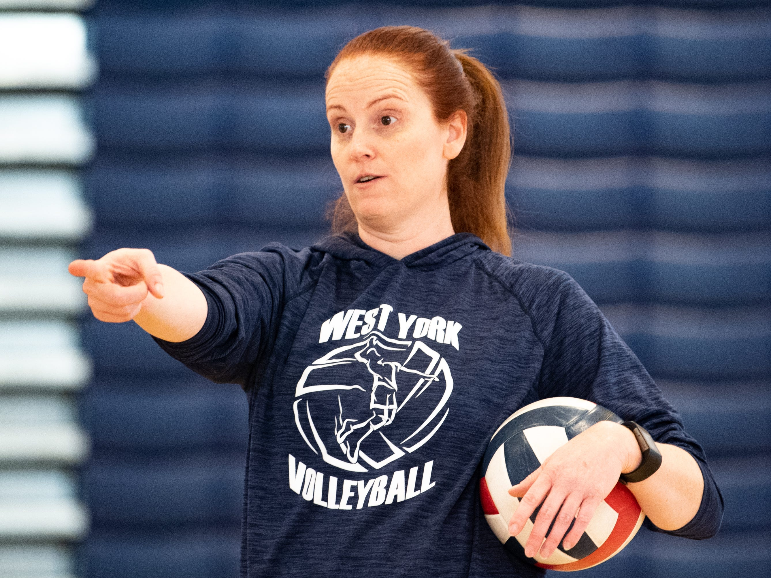 West York's boys' volleyball head coach encourages her team during practice, March 5, 2019.