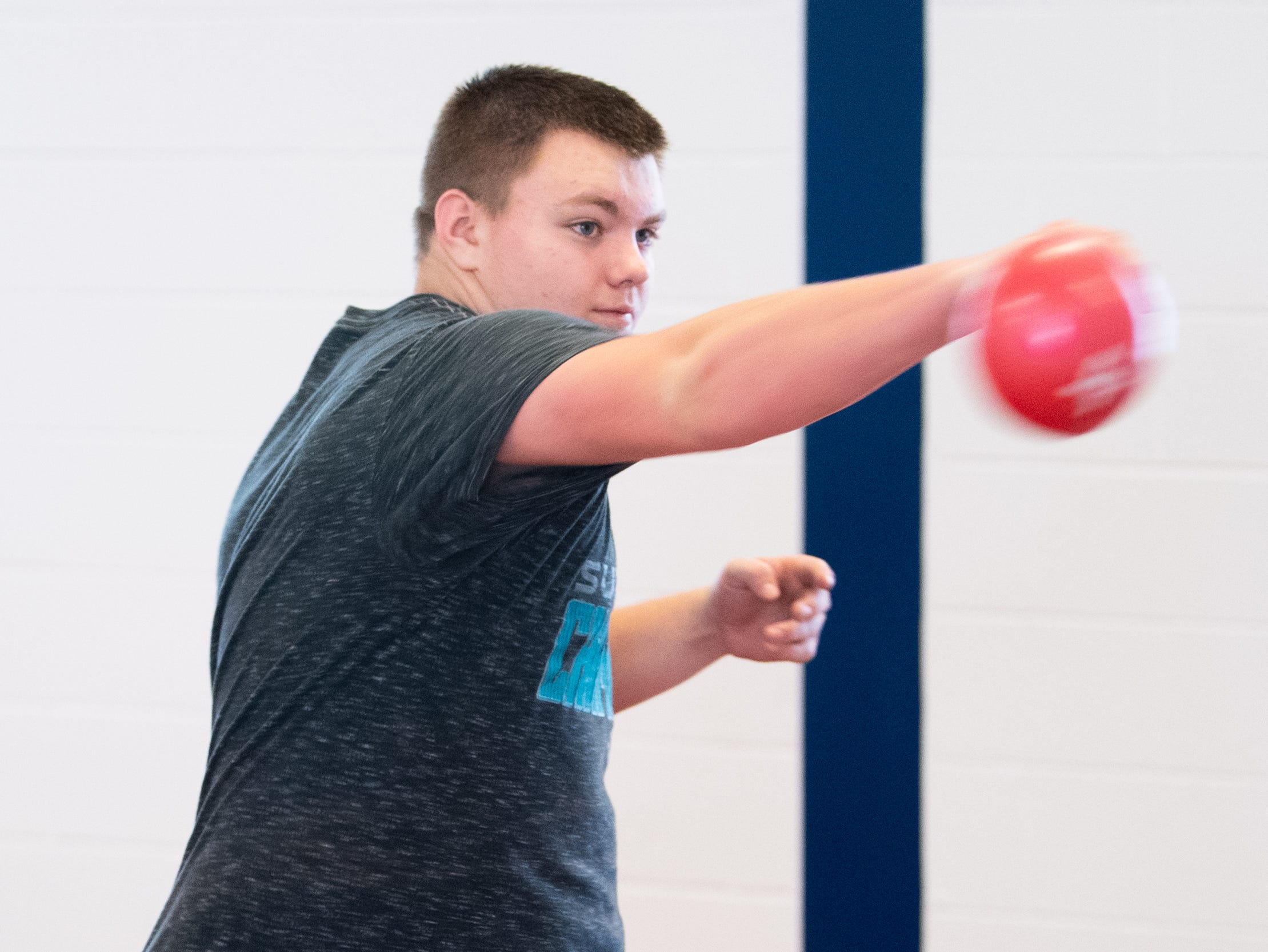 Throwers use small weighted balls to simulate the weight of a discus, March 5, 2019.