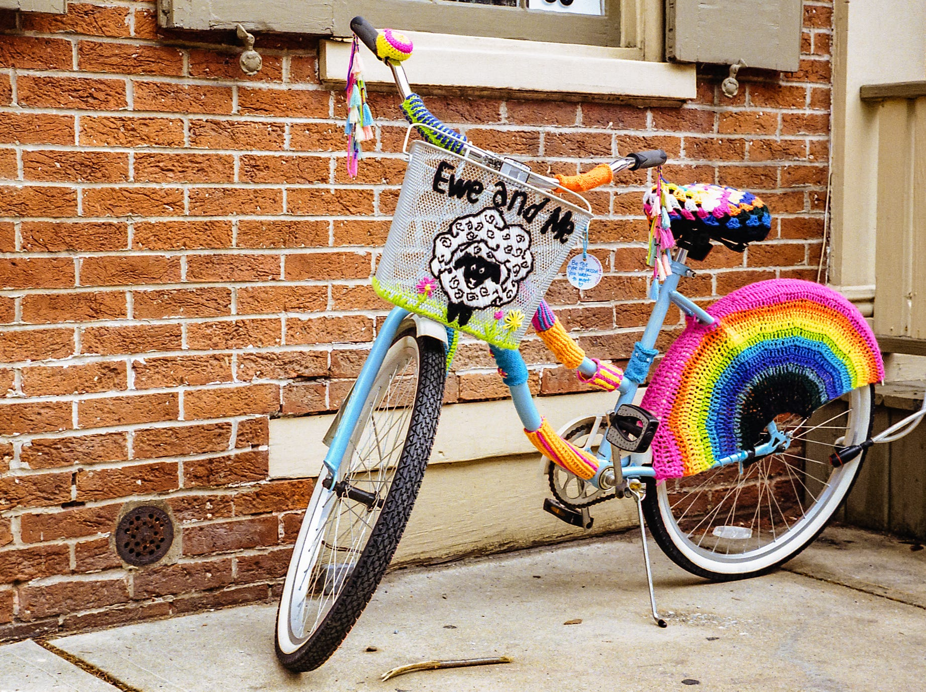 And lastly, he loves the entire process of shooting and developing pictures himself, which he does in the basement of his home.  This is a photo of a bike outside of Ewe and Me Yarn Shop. [Nikon F100] [Kodak Portra 400]