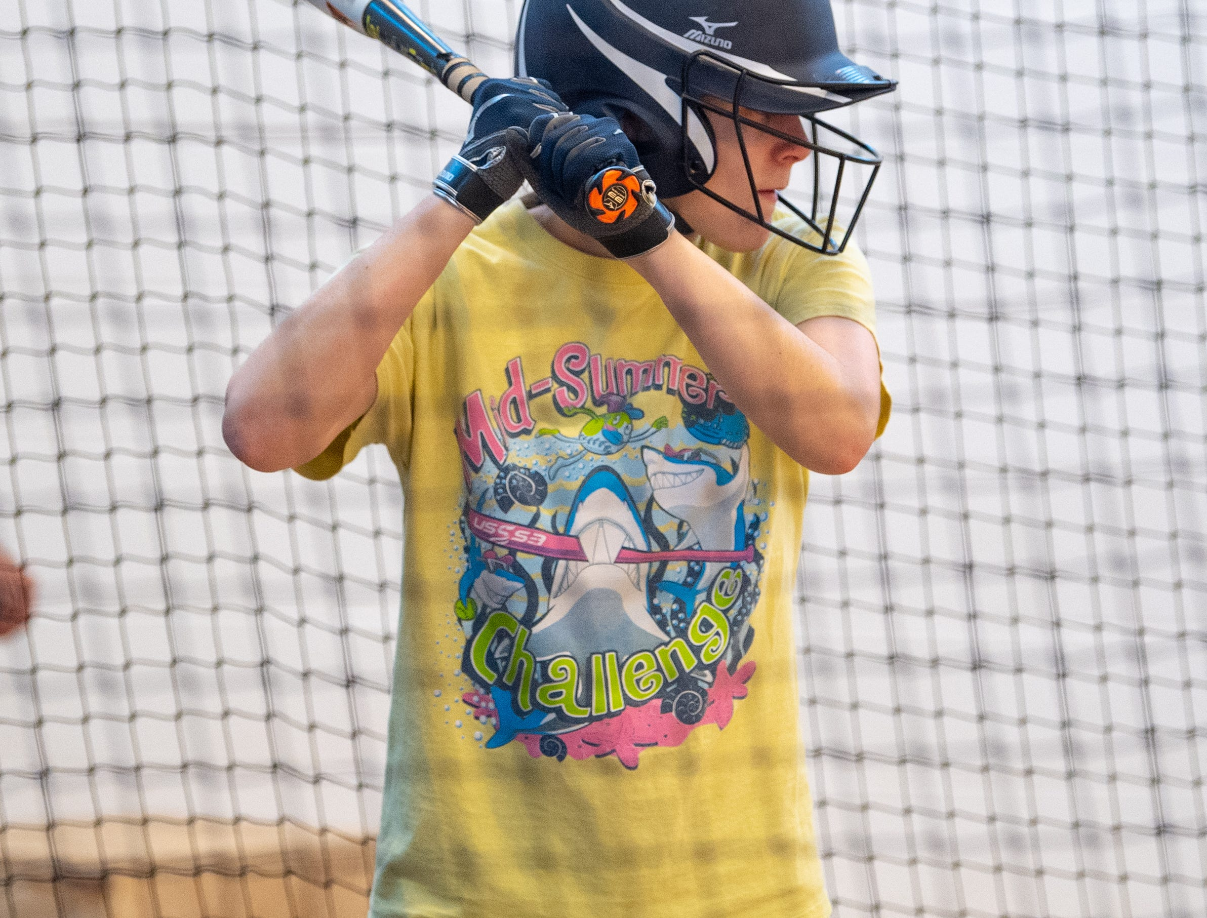 Players take turns batting during West York's softball practice, March 5, 2019.