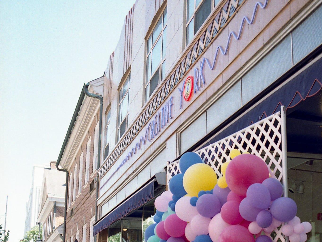 Filling balloons at Creative York. [Pentax KX] [Kodak ProImage 100]