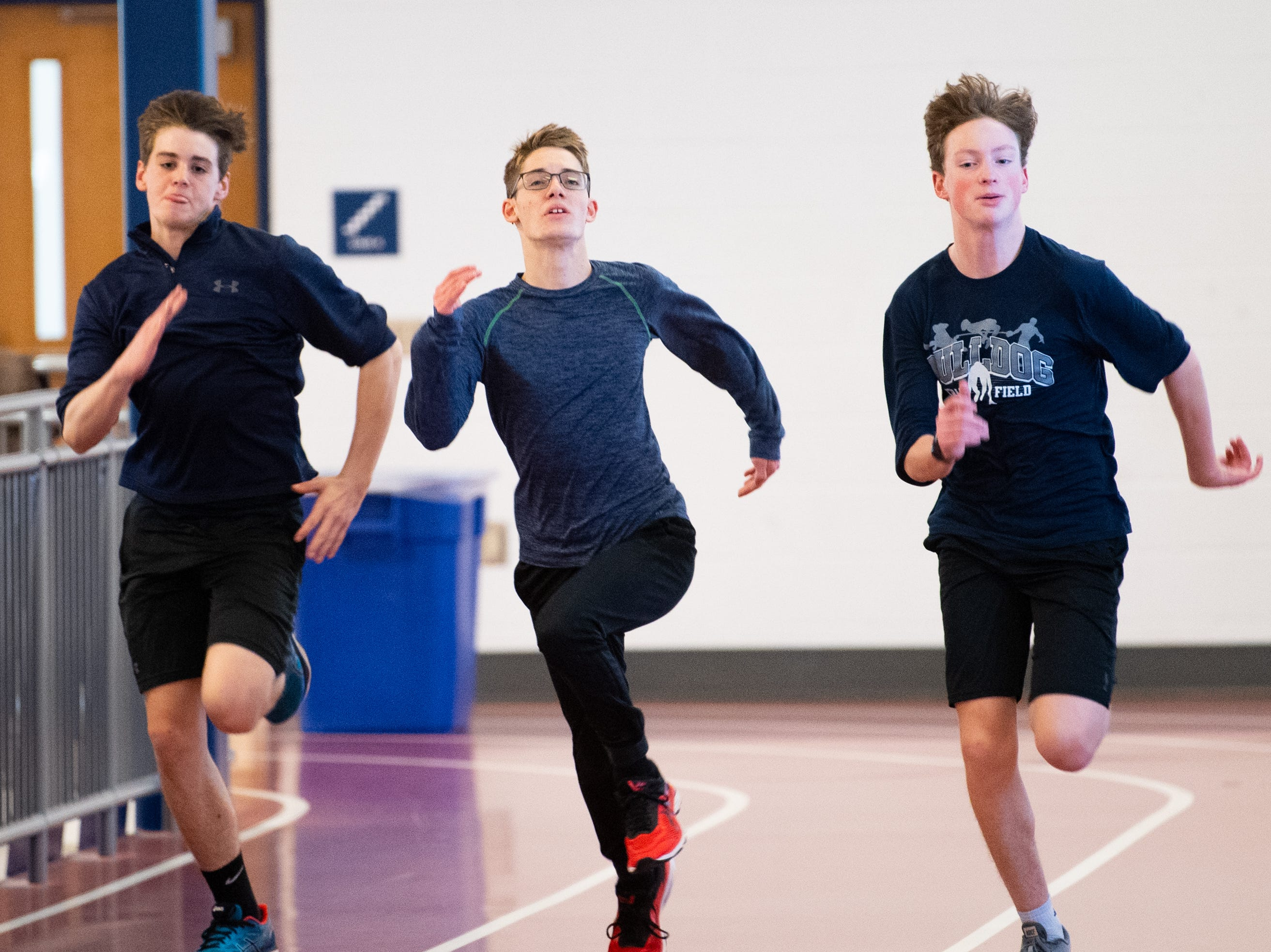 West York sprinters run back and forth, trying to best one another, March 5, 2019.