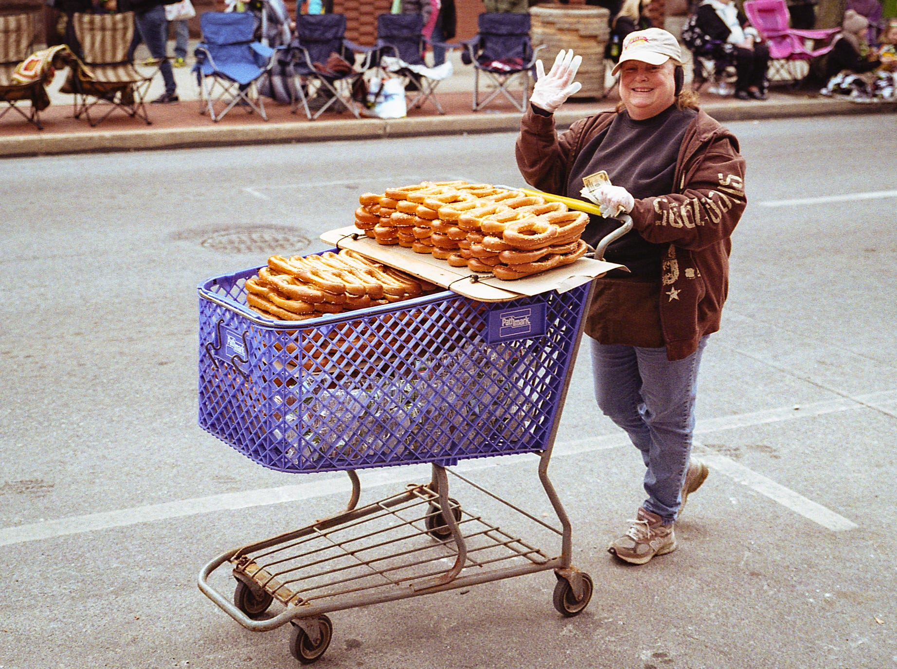 Gentzler began watching YouTube videos, reading books and blogs, listening to podcasts and asking advice about all things photography to learn as much as he could.  This is a photo of a vendor selling pretzels before the 2018 St. Patrick's Day parade. [Nikon F100] [Agfa Vista 200]
