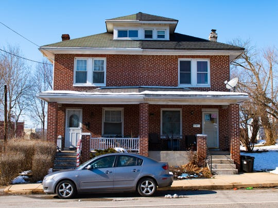 Charles Benjamin answered the door on the left side of this duplex on Parkway Boulevard on Thursday. He denied allegations that he abused five of his children at a home in West York.