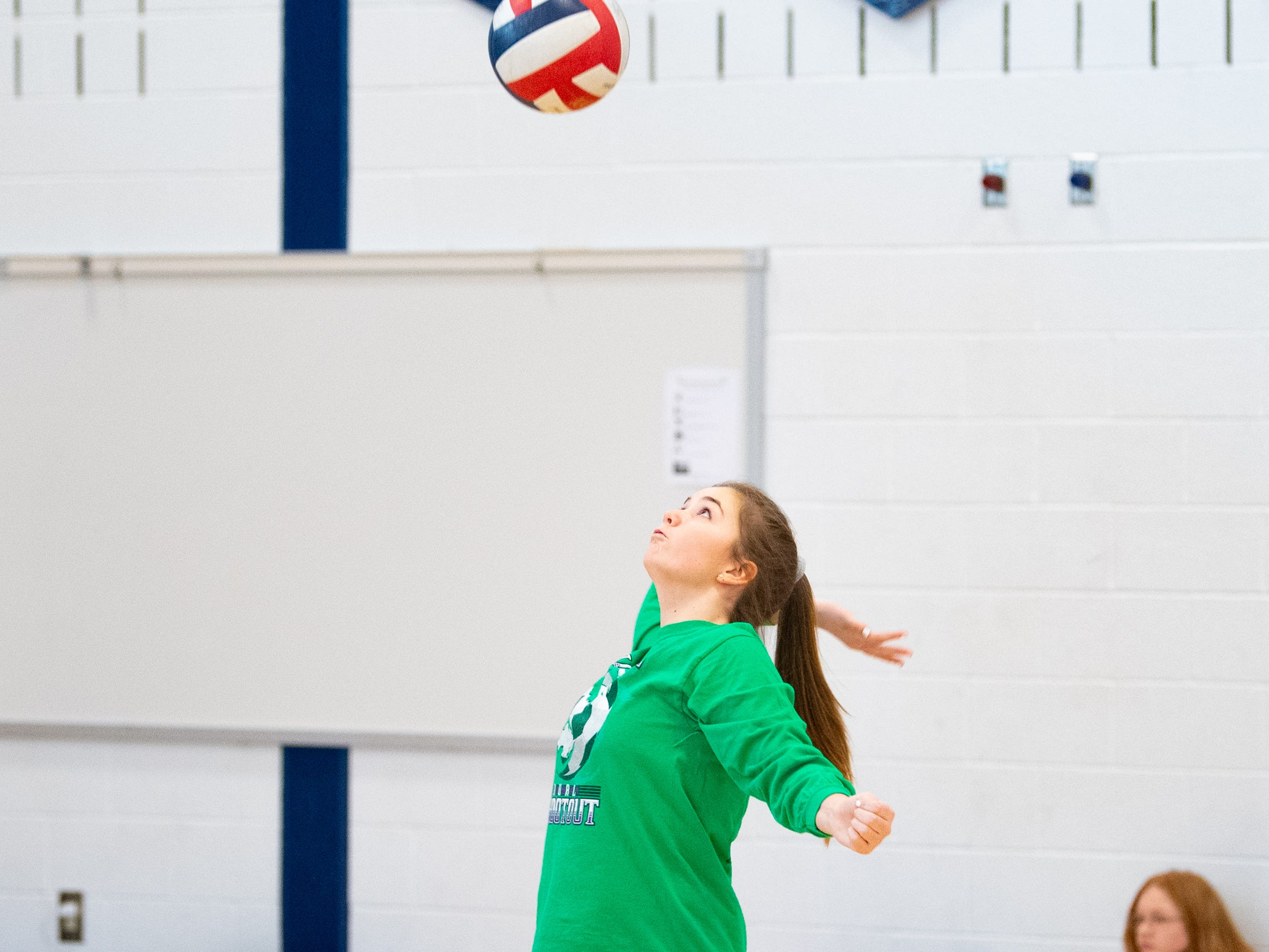 Each girls' volleyball player has their own unique way of serving, March 5, 2019.