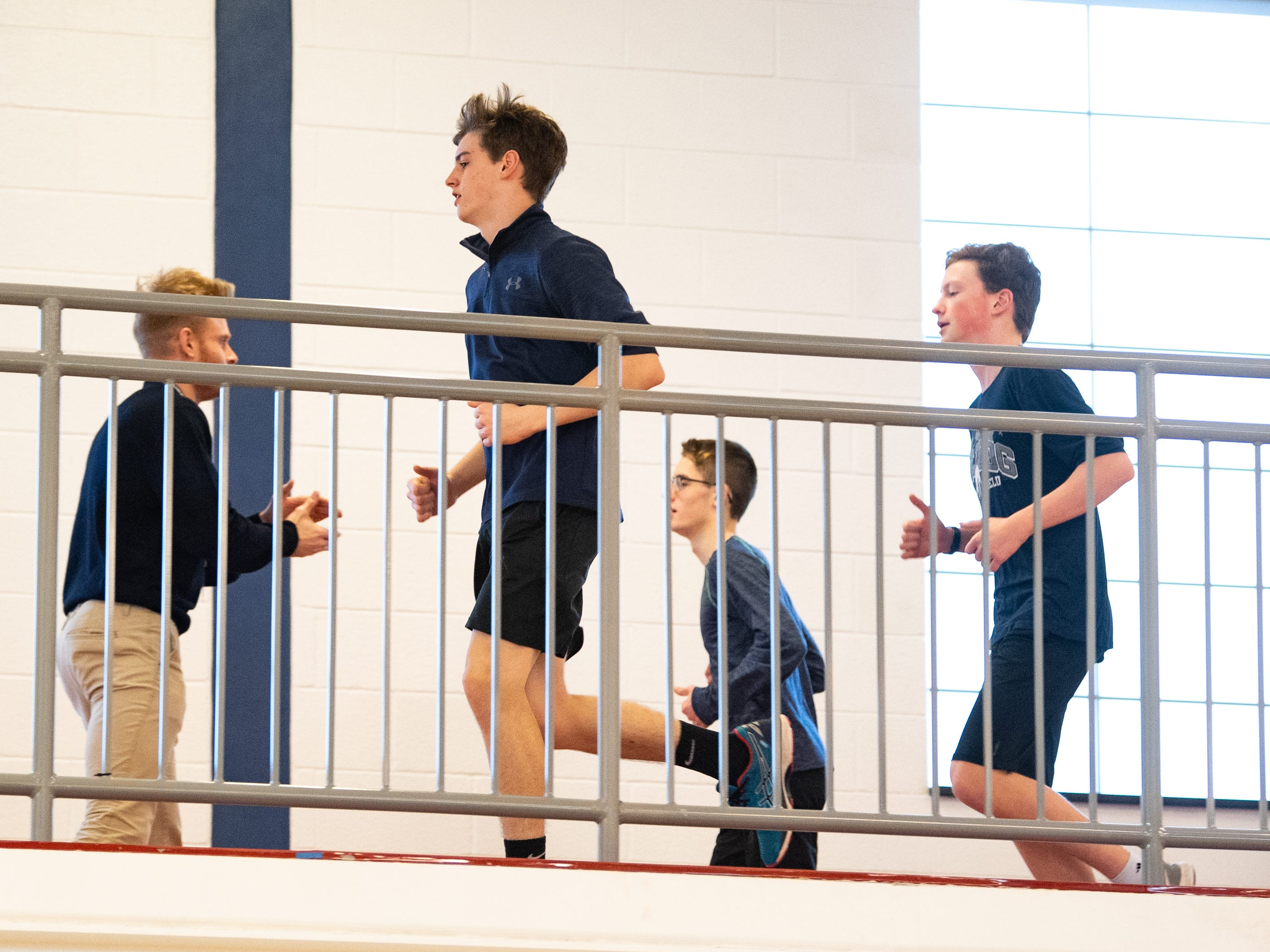 The West York track and field team jogs on the indoor track above the gym, March 5, 2019.