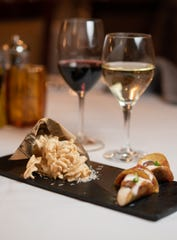 """Pasta puffs, left, and tartare and Parmesan """"taco"""" amuses from the March 21 Ferrari-Carano wine dinner at La Strada in the Eldorado."""