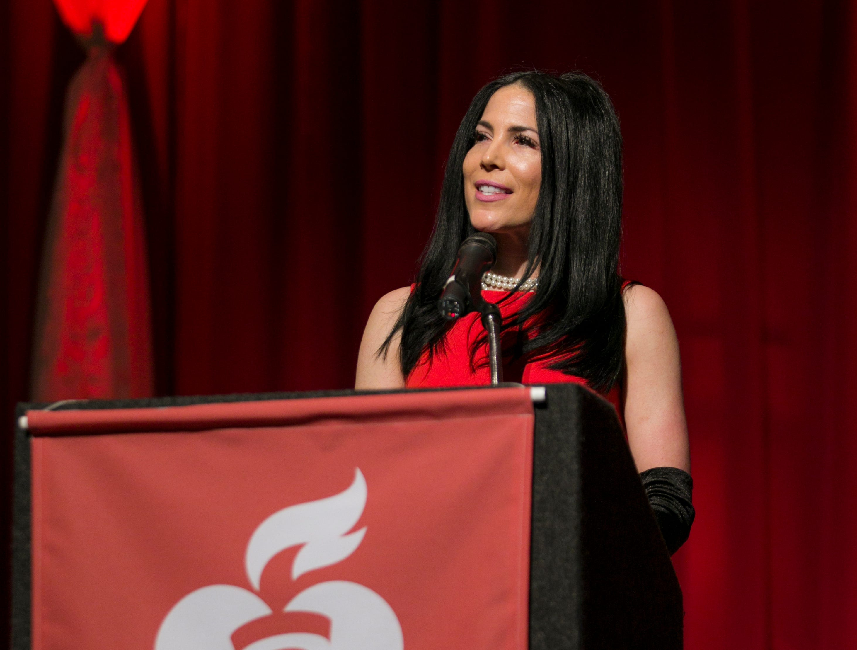 Tiffany Coury, COO Northern Nevada Medical Center and 2019 Go Red for Women Chair, speaks during the 15th Annual Go Red for Women Luncheon on Friday night,March 1, 2019 held at the downtown Reno Ballroom.