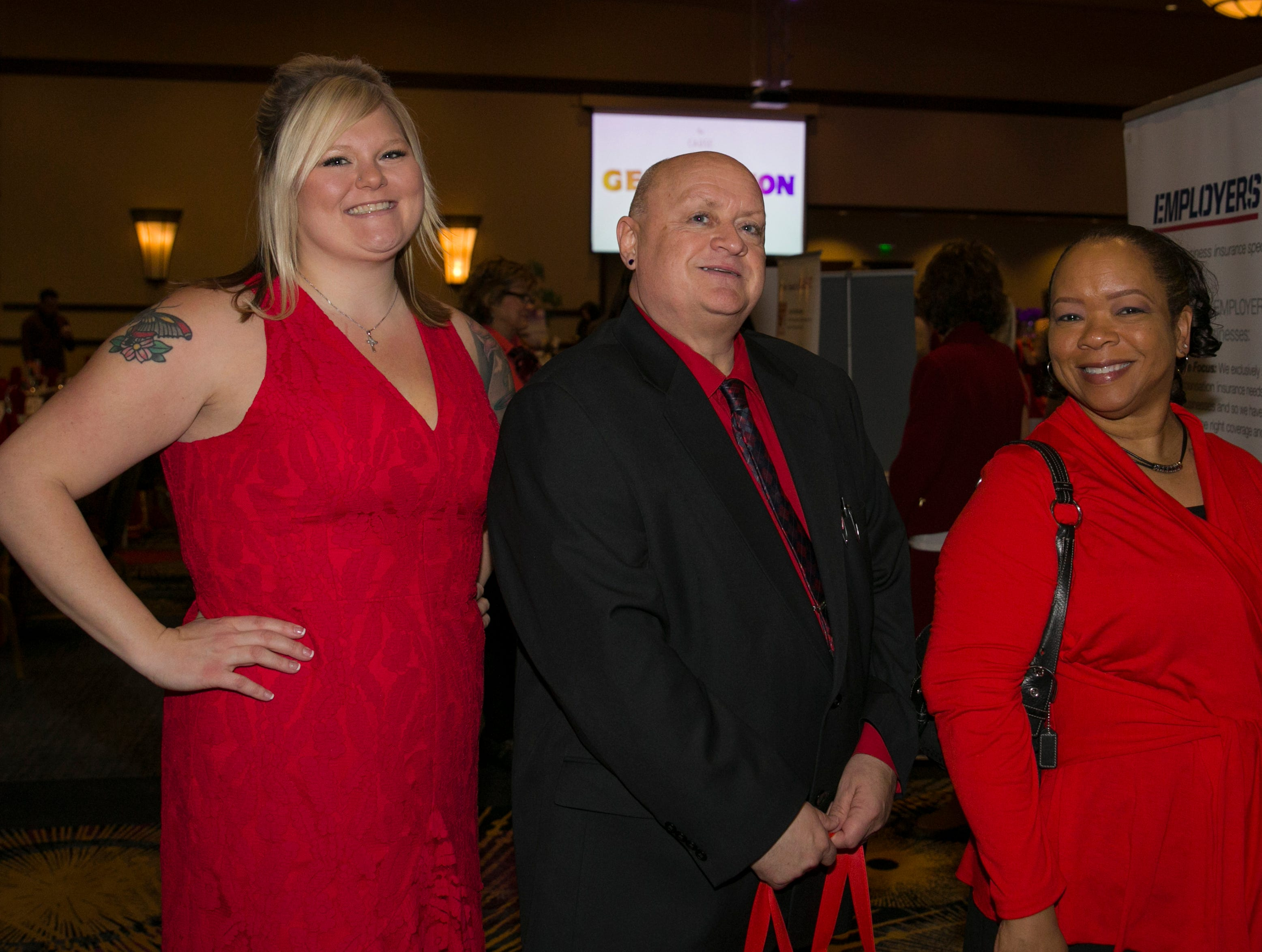 Mel Rems, Jay Wilson and Lilli Walker during the 15th Annual Go Red for Women Luncheon on Friday night,March 1, 2019 held at the downtown Reno Ballroom.