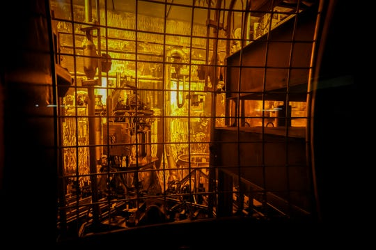 In this Nov. 20, 2013 photo, seen through thick protective glass, shows the area where workers sand-blast the large stainless steel tanks used in the vitrification process to rid them of contaminates at the Defense Waste Processing Facility at the Savannah River Site near Aiken, S.C. Nevada's latest bid to block incoming shipments of weapons-grade plutonium points to the U.S. Energy Department's own scientific warnings about the dangers of prematurely moving the highly radioactive material out of South Carolina. (AP Photo/Stephen B. Morton)