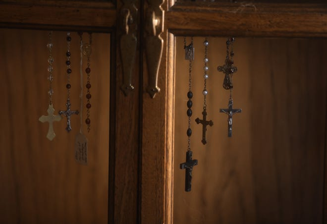 Rosary beads hand in a cabinet.