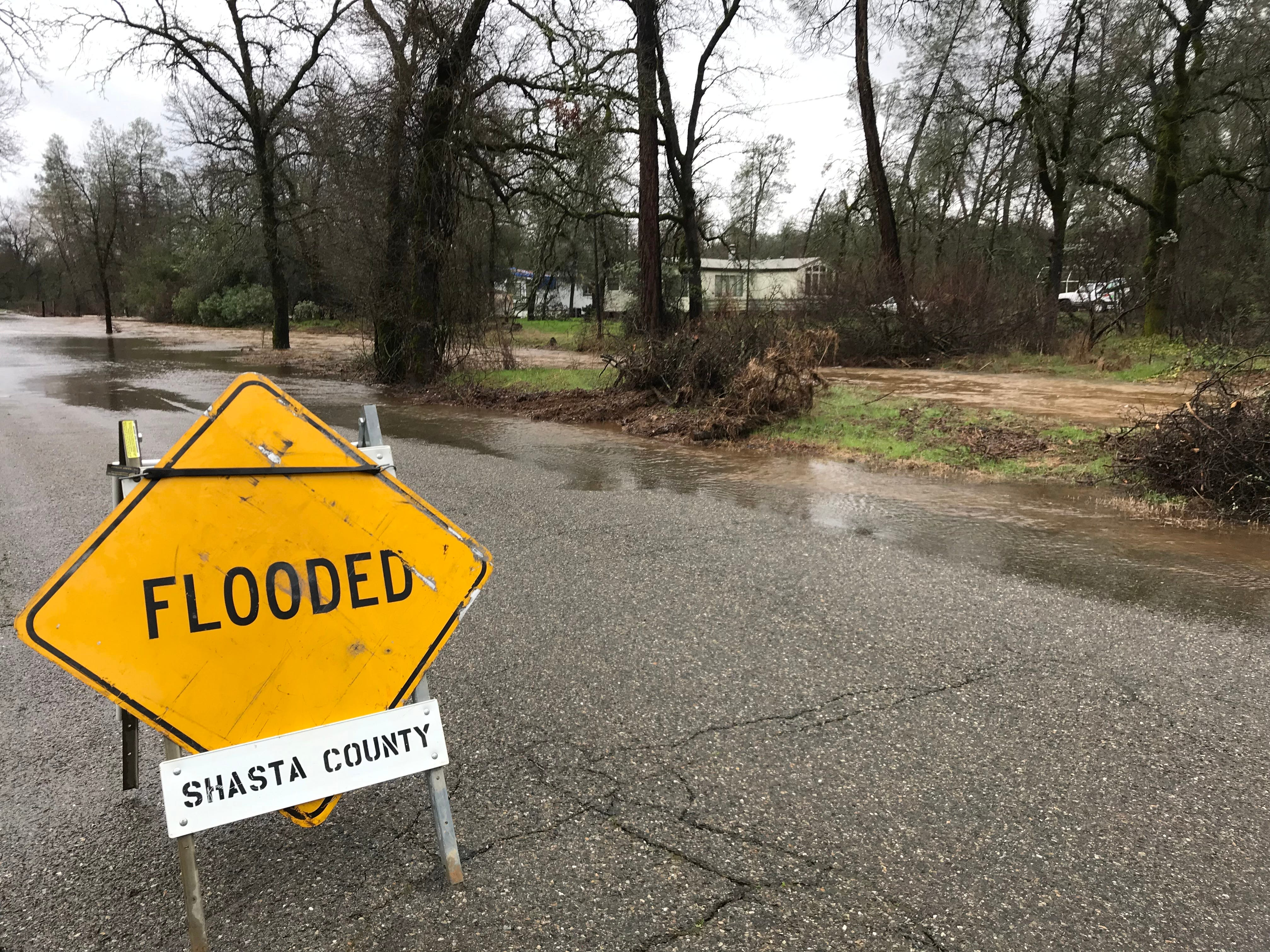 Shasta County Public Works officials closed down Old Oasis Road near Randolph Road after it was flooded by nearby Newton Creek.