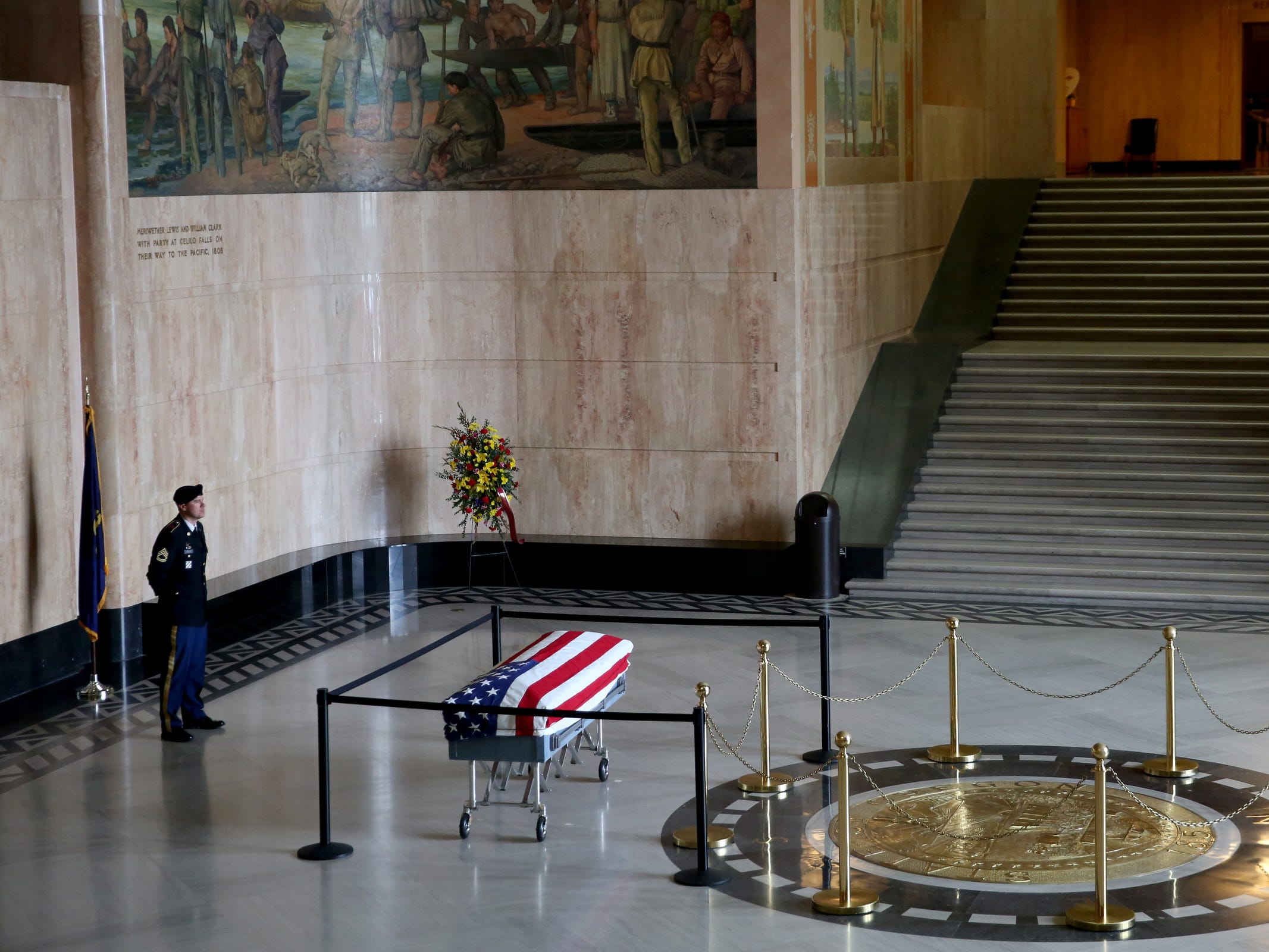 A military member guards the casket of Secretary of State Dennis Richardson in the rotunda at the Oregon State Capitol in Salem on Wednesday, March 6, 2019.