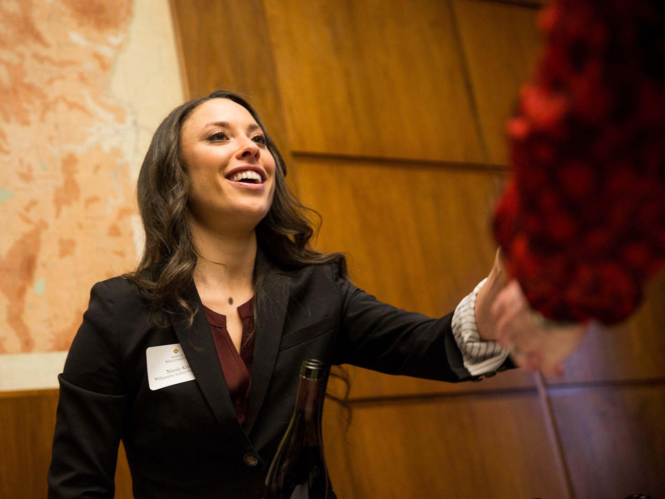 Nicole Krill, Willamette Valley Vineyards Brand Ambassador serves wine to guests at a release party for the Oregon Solidarity Rose of Pinot Noir in Gov. Kate Brown's ceremonial office at the Oregon State Capitol in Salem on Tuesday, March 5, 2019.