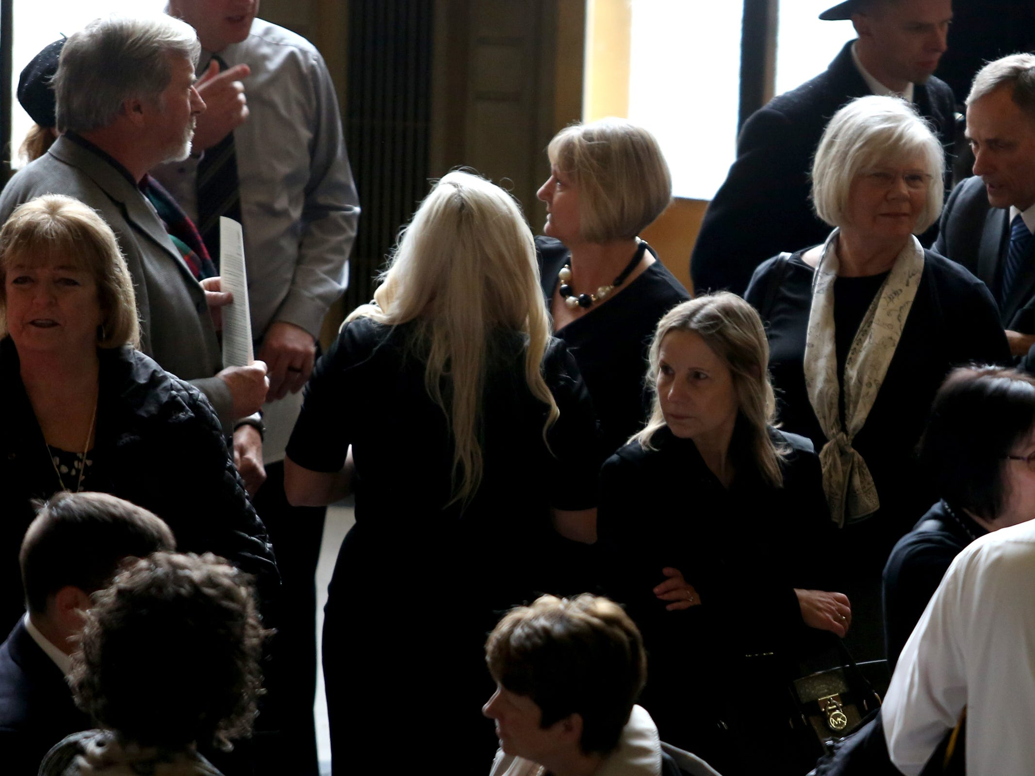 Friends and family gather as Secretary of State Dennis Richardson lies in state in the rotunda at the Oregon State Capitol in Salem on Wednesday, March 6, 2019.