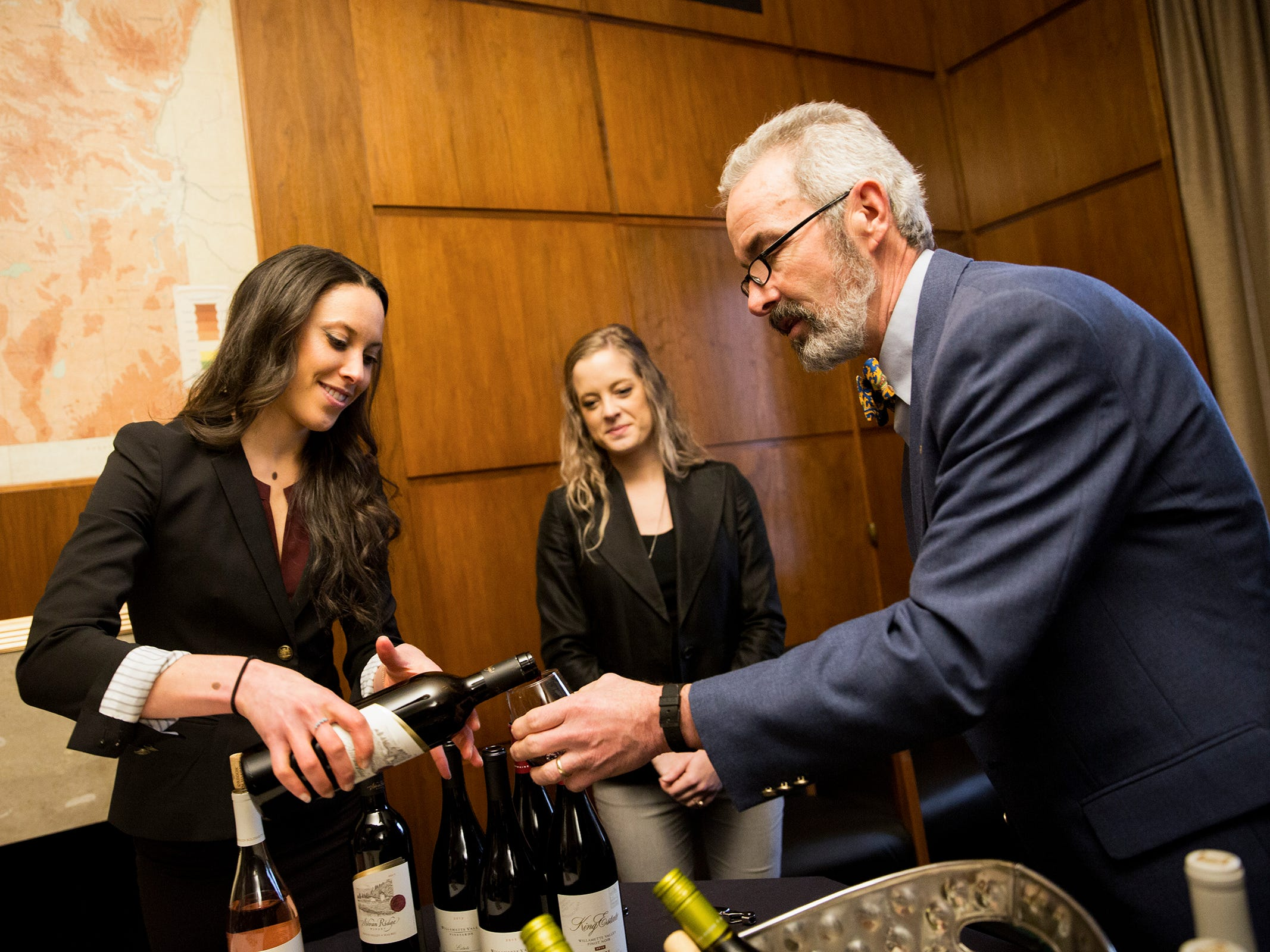Nicole Krill, Willamette Valley Vineyards Brand Ambassador, pours a glass for Sen. Floyd Prozanski at a release party for the Oregon Solidarity Rose of Pinot Noir in Gov. Kate Brown's ceremonial office at the Oregon State Capitol in Salem on Tuesday, March 5, 2019.