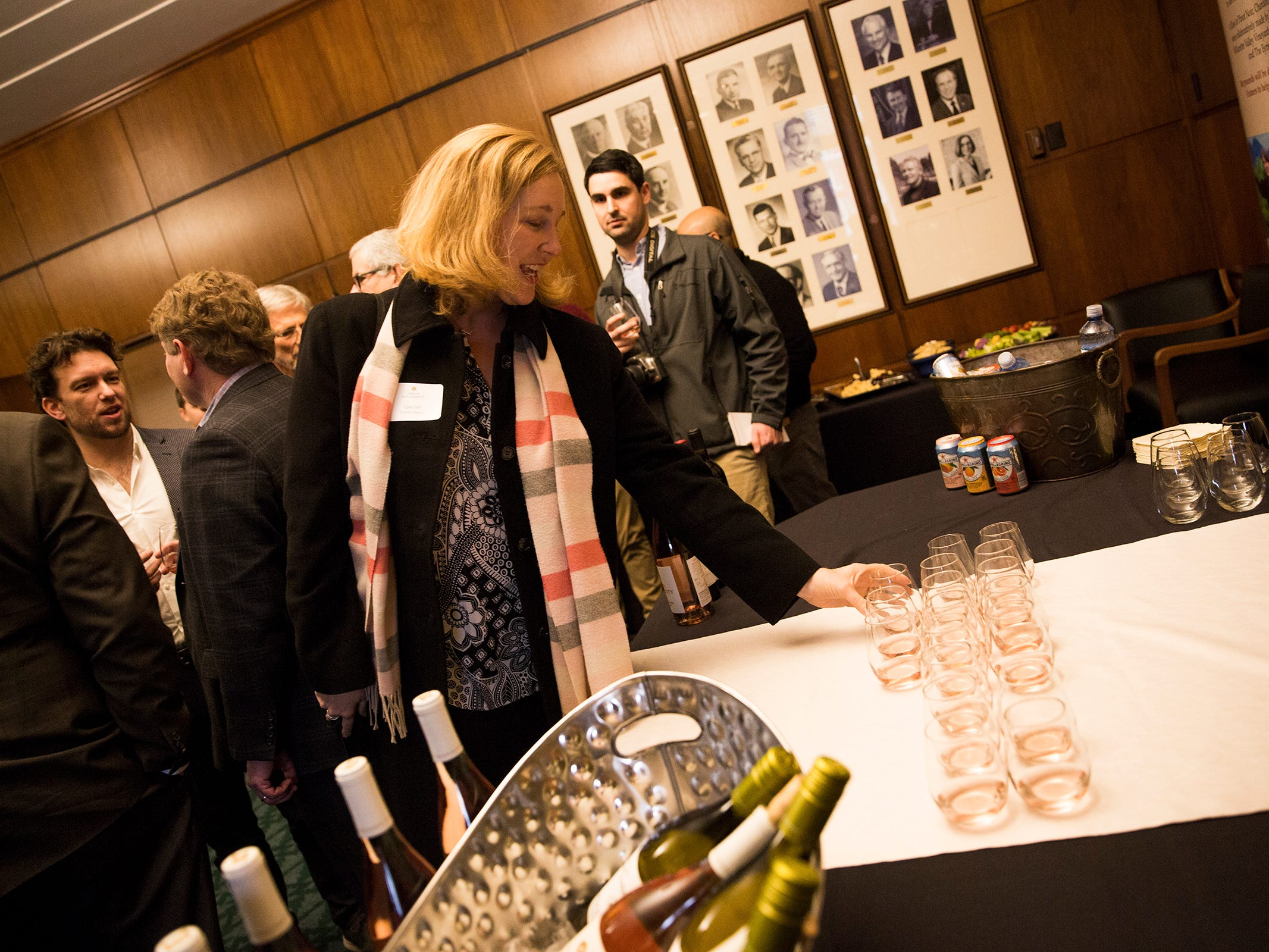 Lisa Itel, Director of Strategic Partnerships at Travel Oregon, grabs a glass at a release party for the Oregon Solidarity Rose of Pinot Noir in the Governor's ceremonial office at the Oregon State Capitol in Salem on Tuesday, March 5, 2019.