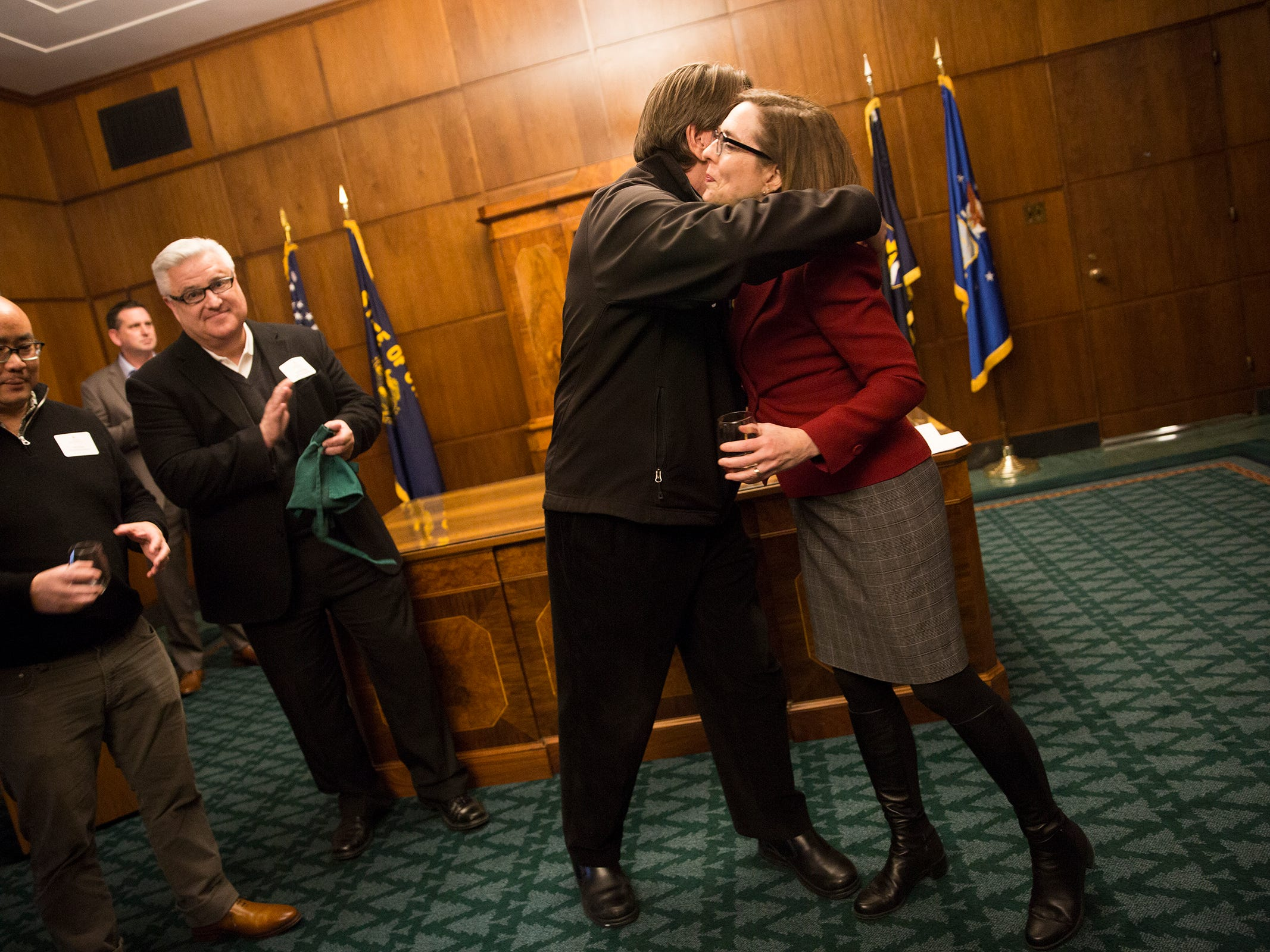Willamette Valley Vineyard founder and president Jim Bernau and Gov. Kate Brown hug after their toast at a release party for the Oregon Solidarity Rose of Pinot Noir in the Governor's Kate Brown's ceremonial office at the Oregon State Capitol in Salem on Tuesday, March 5, 2019.