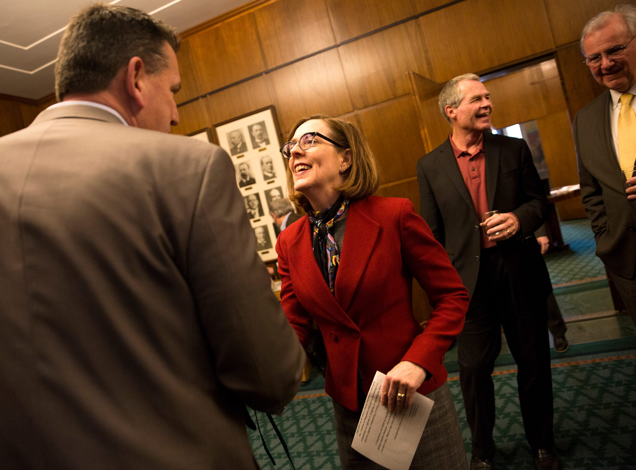 Gov. Kate Brown greets Oregon winery representatives at a release party for the Oregon Solidarity Rose of Pinot Noir in the Governor's ceremonial office at the Oregon State Capitol in Salem on Tuesday, March 5, 2019.