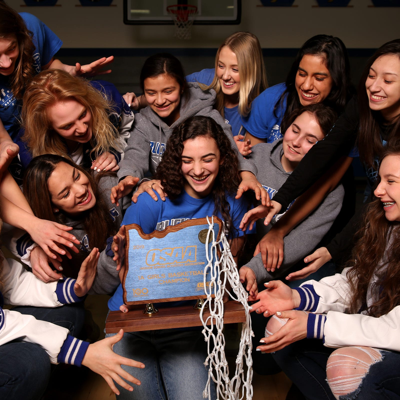 Undefeated in two sports; St. Paul girls win basketball and volleyball titles