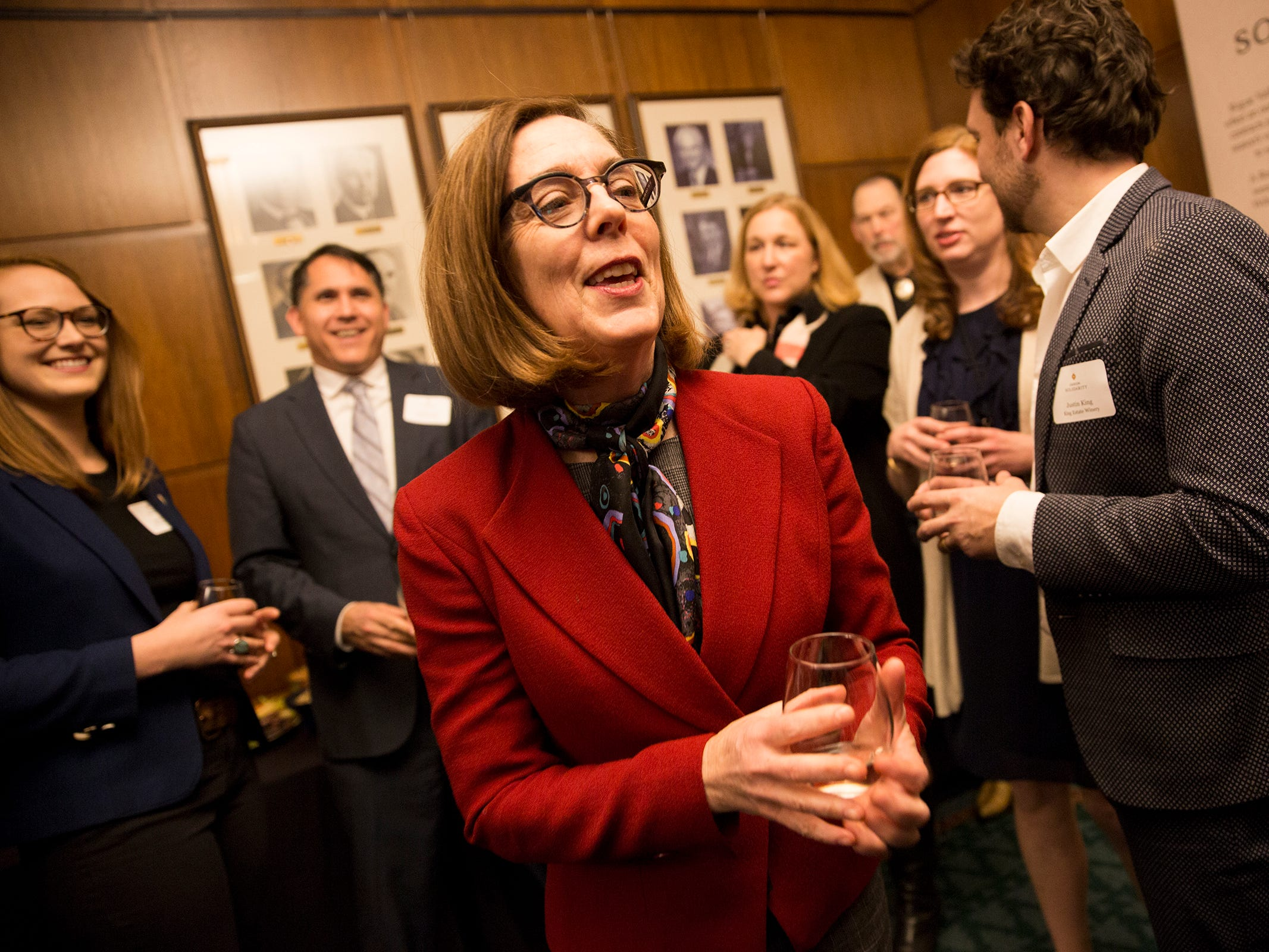 Gov. Kate Brown makes her way around the room at a release party for the Oregon Solidarity Rose of Pinot Noir in the Governor's ceremonial office at the Oregon State Capitol in Salem on Tuesday, March 5, 2019.