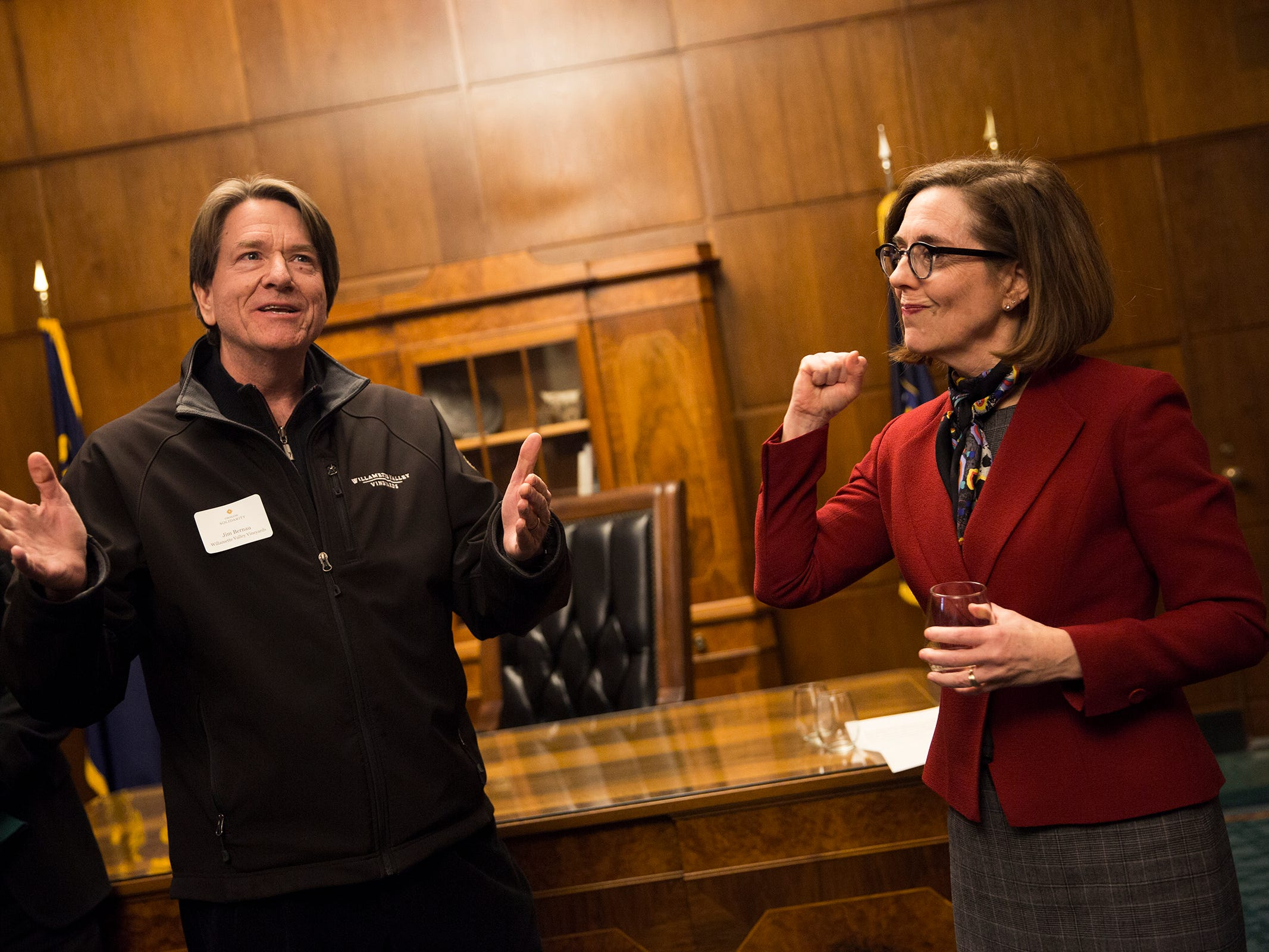 Willamette Valley Vineyard founder and president Jim Bernau and Gov. Kate Brown speak at a release party for the Oregon Solidarity Rose of Pinot Noir in the Governor's ceremonial office at the Oregon State Capitol in Salem on Tuesday, March 5, 2019.