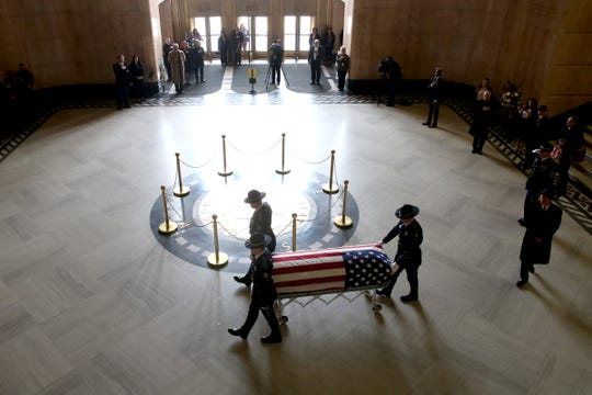 The casket of Secretary of State Dennis Richardson is brought into the rotunda at the Oregon State Capitol in Salem on Wednesday, March 6, 2019.