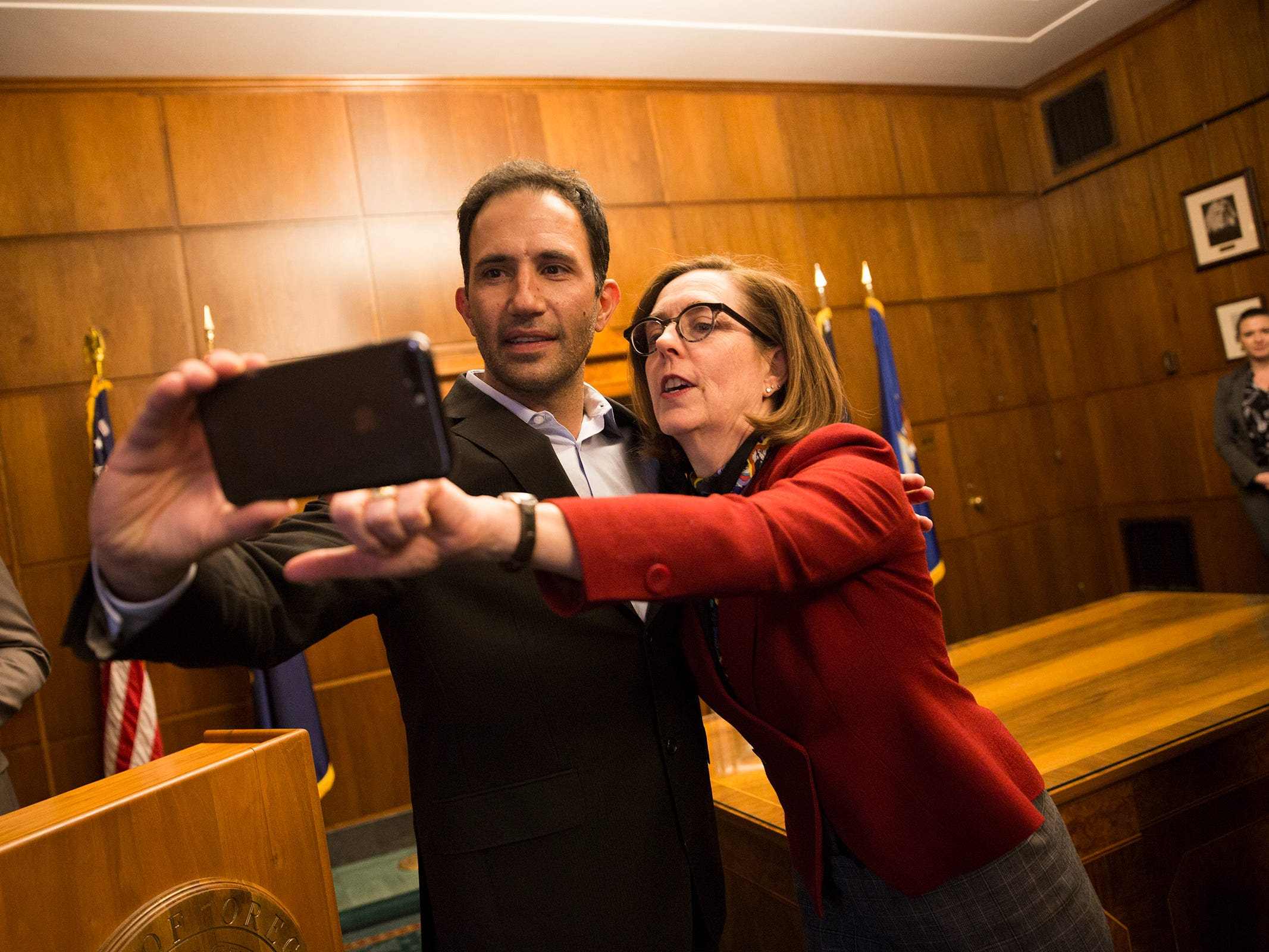 Juan Pablo ÒJPÓ Valot, head winemaker for Silvan Ridge Winery, takes a selfie with Gov. Kate Brown at a release party for the Oregon Solidarity Rose of Pinot Noir in the Governor's ceremonial office at the Oregon State Capitol in Salem on Tuesday, March 5, 2019.
